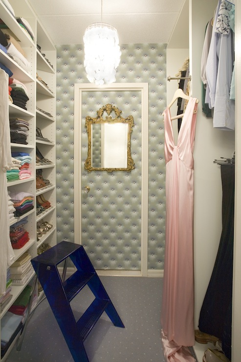 Chic Gray Tufted Padded Walk In Closet Design With Capiz Chandelier, Blue  Lucite Closet Ladder, Gold Leaf Gilt Ornate Mirror And Built Ins.