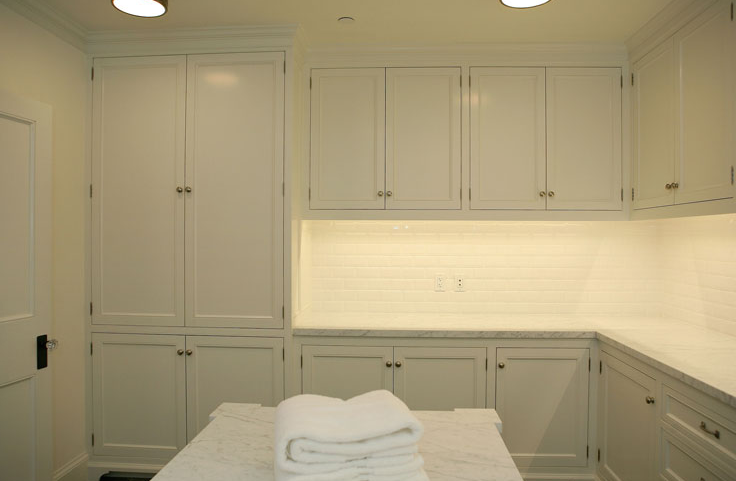 white laundry room cabinets transitional laundry room giannetti home. Black Bedroom Furniture Sets. Home Design Ideas