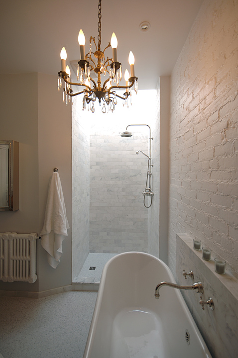 Gorgeous Master Bathroom Design With White Exposed Brick Wall, Soaking Tub,  White Carrara Marble Subway Tiles Shower Surround, Polished Nickel Wall Mount  ...