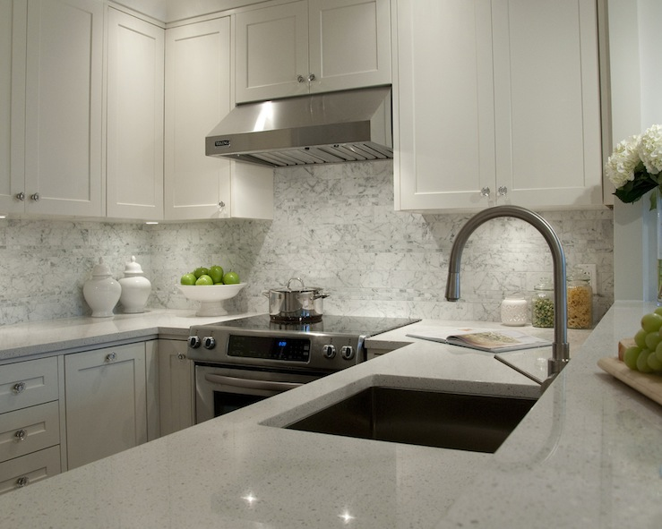 White granite countertops transitional kitchen for White kitchen cabinets with white marble countertops