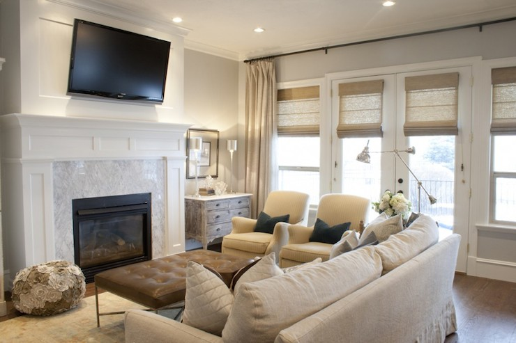 Tv over fireplace transitional living room alice for Family room furniture layout tv fireplace