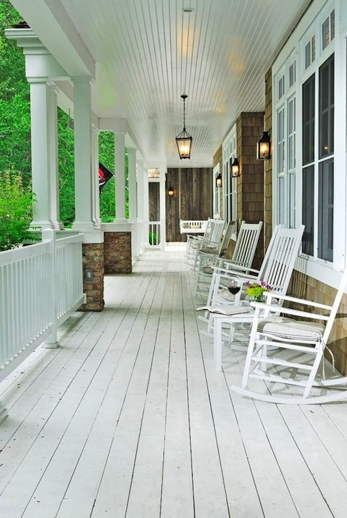 porch with white washed wood plank floors, white rocking chairs ...