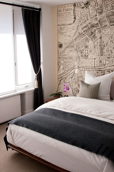 Vintage world map wallpaper design ideas via design sponge jess loras beautiful city bedroom design with vintage map wallpaper modern platform bed gray flannel blanket taupe pillows and black gumiabroncs Image collections