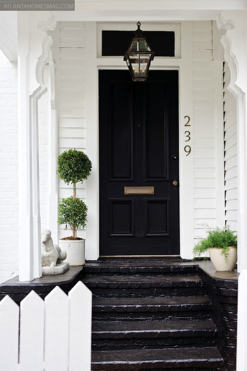 White house with black front door cottage home Dark green front door paint