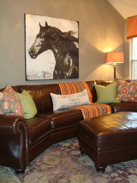 Family/TV Room Brown Leather Couch With Nailhead Trim, Brown/gray Or Gray/brown  Wall Color With Pops Of Orange, Green And Purple.