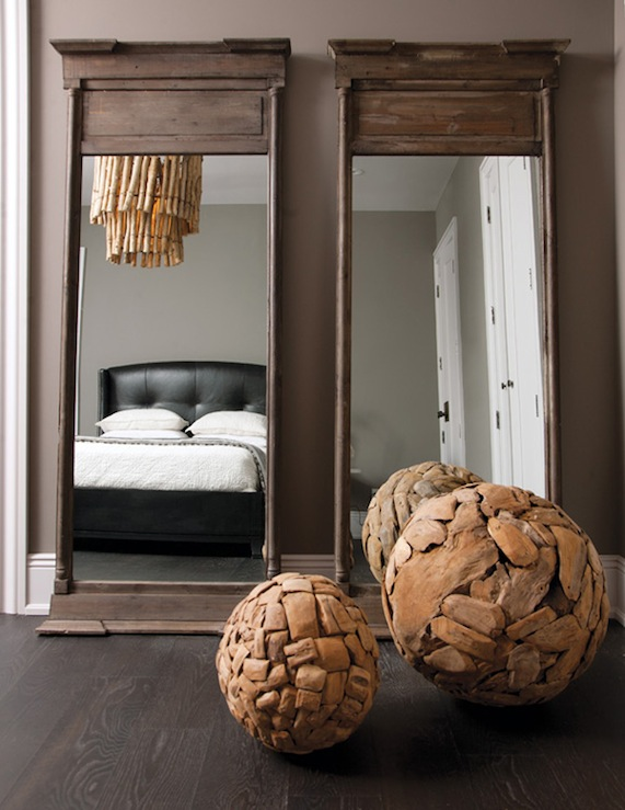 chic bedroom design with gray brown walls paint color rustic floor mirrors wood chandelier and black leather tufted wingback bed