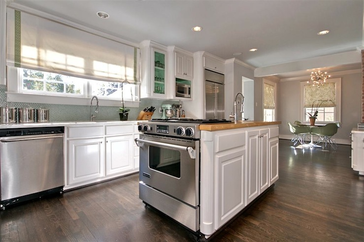 Gorgeous Kitchen Design With Gray Walls Paint Color White Kitchen Cabinets With Calcutta Marble Counter Tops White Kitchen Island With Butcher Block