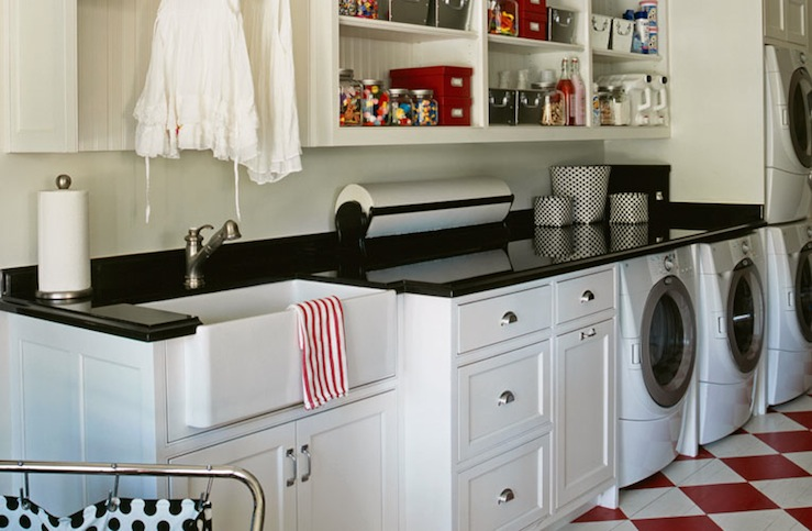 Fun, eclectic laundry room design with white utility cabinets and ...