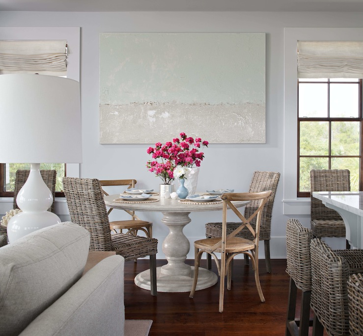 Beachy Dining Room Design With Pale Blue Walls Paint Color, Canvas Art,  Marble Pedestal Round Dining Table, French X Back Cafe Chairs, Seagrass  Chairs And ...