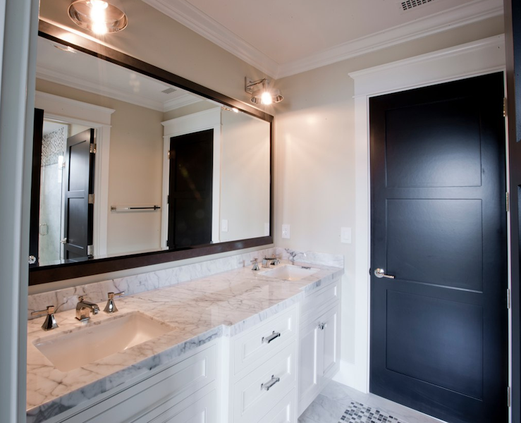 White Double Bathroom Vanity Calcutta Marble Counter Tops Double Sinks Polished Nickel Faucets Ebony Rectangular Wood Mirror And Matte Black Door