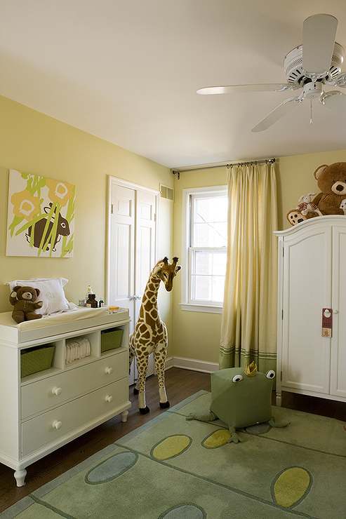 Adorable Yellow U0026 Green Gender Neutral Nursery Design With Yellow Walls  Paint Color, Green Rug, White Dresser Changing Table, White Armoire,  Giraffe And Two ...