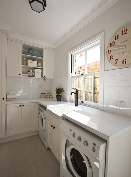 Clean Open Laundry Room Design With Ivory Ikea Kitchen Cabinets, Glossy  White Beveled Subway Tiles Backsplash, Farmhouse Sink, White Washer U0026 Dryer  And ...