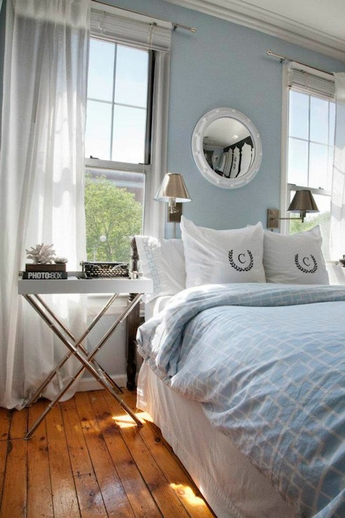 Blue Bedroom Design With Blue Walls Paint Color, White Porthole Mirror,  Blue Geometric Bedding, Monogrammed Pillows, White Tray Table With Polished  Nickel ...