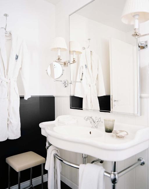Michele Bonan   Gorgeous white  amp  black bathroom design with white  amp  black walls  white washstand  mirror  beadboard  polished nickel stool and polished. Two Tone Bathroom Vanities Design Ideas