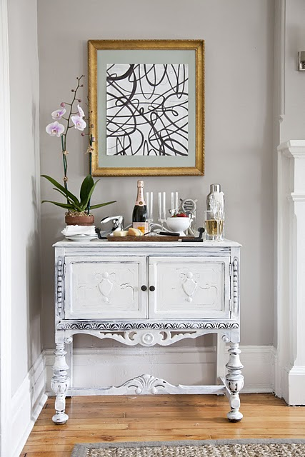 Whitewashed cabinet transitional living room the for Elegant foyer decor