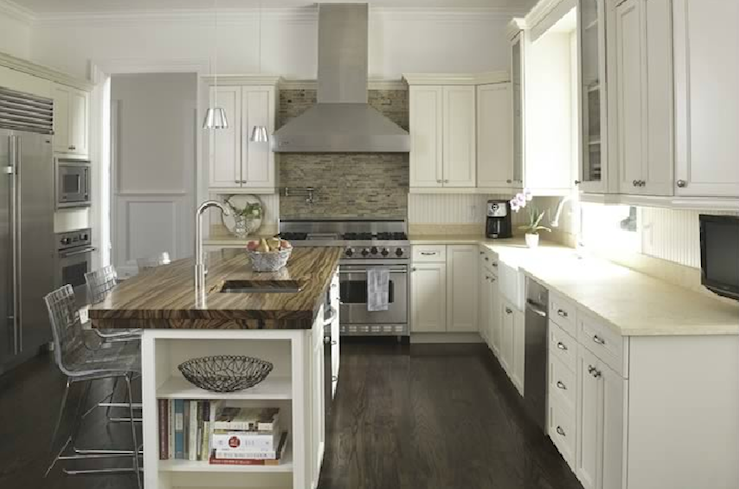 Lovely kitchen design with ivory kitchen cabinets with corian counter