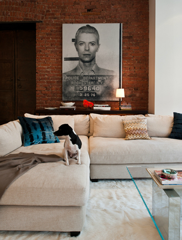 Fun Living Room Design With Oatmeal Linen Modern Sectional Sofa Exposed Brick Wall Steel Cocktail Table Glass Top And David Bowie