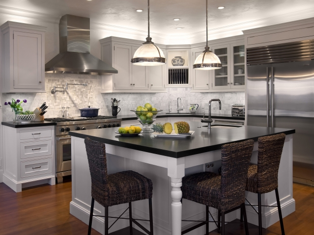 Charming Kitchen With Island And Stainless Steel Appliances