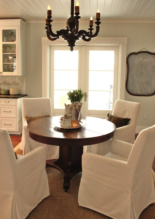Classic Dining Room Design With Ikea Henriksdal Slip Covered Armchairs,  Lowes Seagrass Rug, Antique French Wood Chandelier, Walnut Pedestal Dining  Table, ...