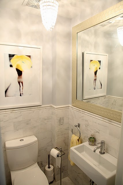 Gorgeous Yellow And Gray Bathroom With A Pop Of Yellow! Blue Walls Paint  Color, Marble Tiles Backsplash, Wall Mount Modern Sink, Crystal Chandelier  And Pop ...