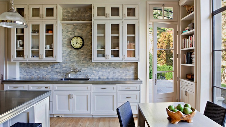 Kitchen Design With Ivory Glass Front Kitchen Cabinets, Stone Tiles  Backsplash, Gray Counter Tops, Ivory Kitchen Island, Oak Modern Dining  Table And Black ...