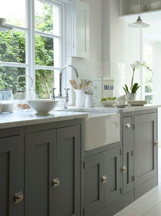 via Pinterest Stunning kitchen with gray cabinets  polished nickel latches farmhouse sink marble counter tops gooseneck bridge Gray Farmhouse Kitchens Design Ideas