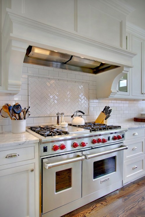 counter tops wolf range and herringbone subway tile backsplash