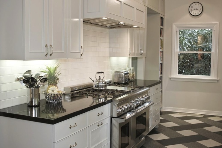 Polished black countertops transitional kitchen newman and wolen design - White kitchen dark counters ...