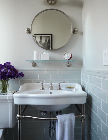 chic bathroom with round pivot mirror waterworks palladio two leg single washstand blue gray glass tiles backsplash and glass bathroom shelf - Glass Tile Backsplash In Bathroom