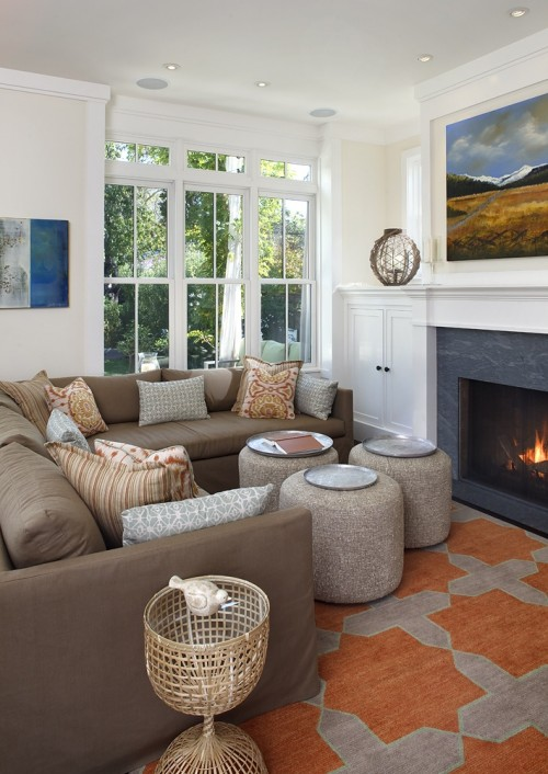 Eclectic orange & gray living room design with orange & gray wool rug, gray  wool round ottomans stools, brown slipcovered sectional sofa, orange & blue  ...