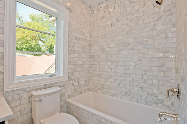 Calcutta gold marble subway tile transitional bathroom for Bathroom ideas marble tile