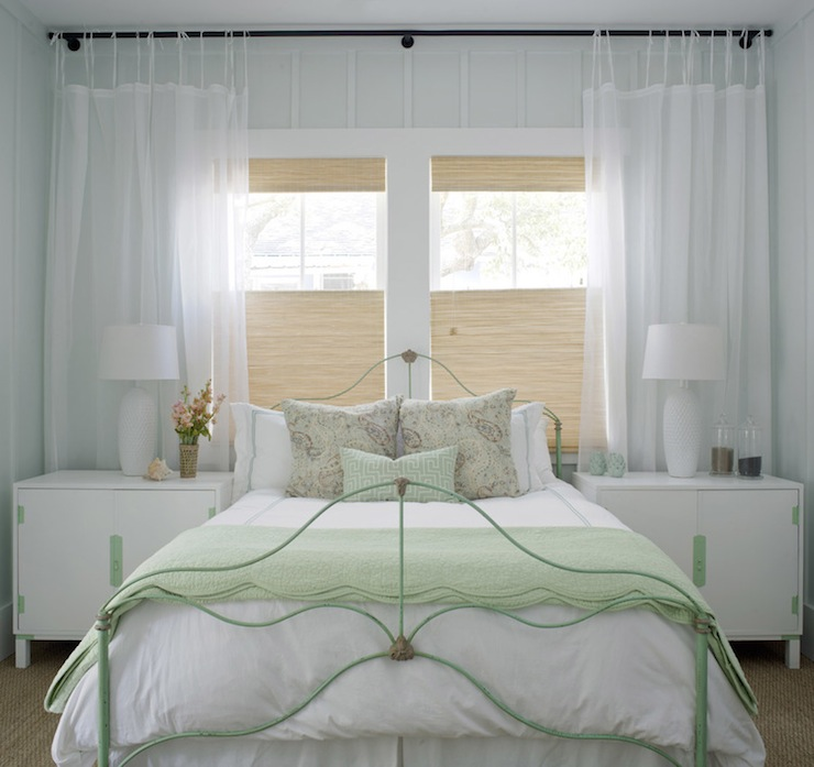 Bed in front of window cottage bedroom sherwin williams sea salt rethink design studio Master bedroom bed against window