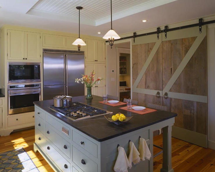 Barn doors in kitchen country kitchen hutker architects for Barn style kitchen cabinets