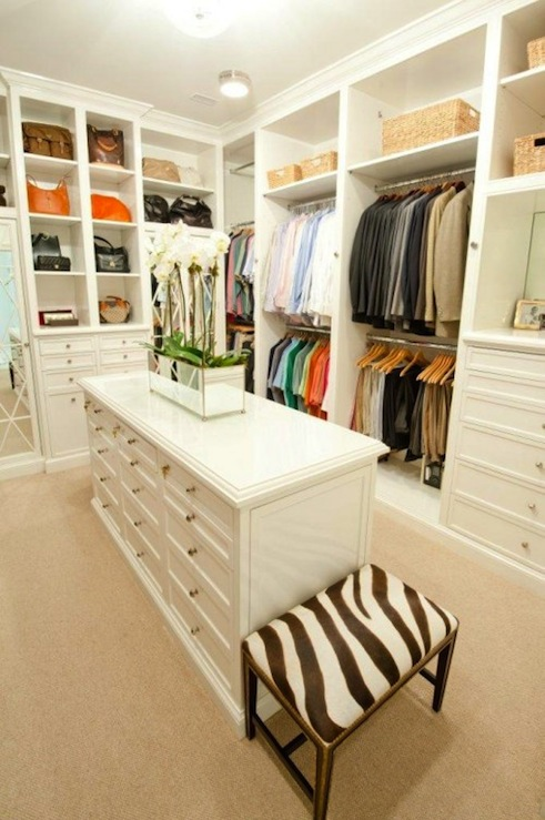 Fantastic Walk In Closet Design With White Built Ins Island Mirrored Planter And Zebra Bench