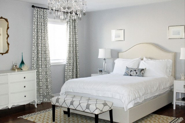 Cream Upholstered Bed Against White Walls