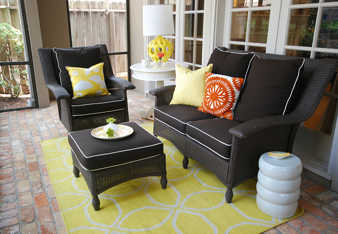 yellow u0026 black sunroom with wicker furniture cushions white piping graphic rug modern garden stool kenneth wingard for
