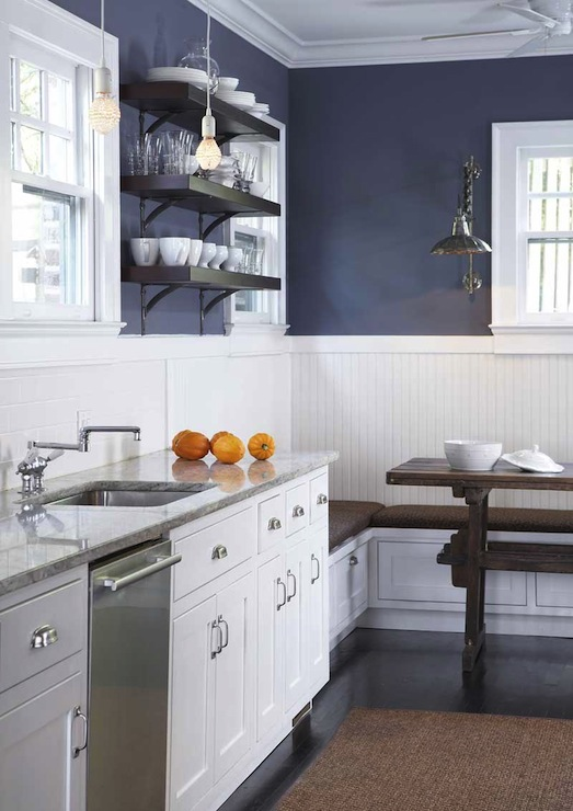 White & navy blue kitchen design with navy blue walls, chair rail with