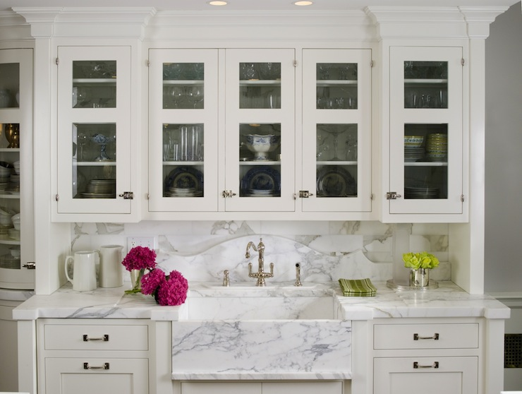 Gorgeous Kitchen With Glass Front White Kitchen Cabinets, Marble  Countertops U0026 Backsplash And Marble Apron Sink.