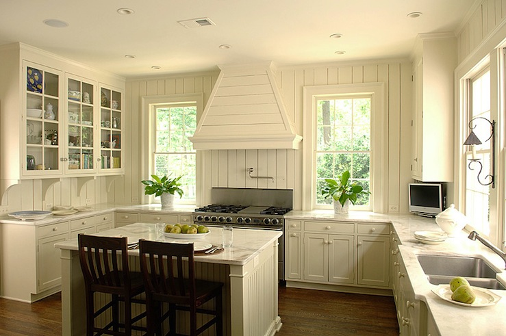 Cottage kitchen design with Ivory walls paint color  ivory shaker kitchen  cabinets  ivory beadboard kitchen island  pot filler  tv and marble  countertops Ivory Kitchen Cabinets Design Ideas. Ivory Kitchens Design Ideas. Home Design Ideas