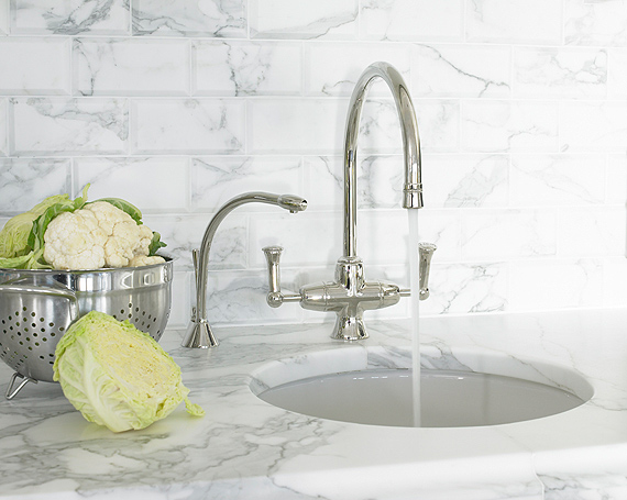 stunning sink area in kitchen with round sink polished nickel gooseneck faucet marble countertop and marble subway tiles backsplash - Marble Subway Tile