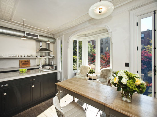 ... Kitchen In Brooklyn Townhouse With Black Kitchen Cabinets, Floating  Shelves, Sink In Kitchen Island, Gray Dining Table With Turned Legs And Bay  Windows.