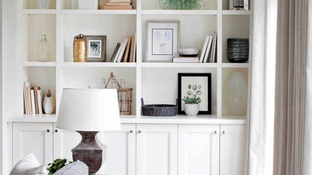Lovely Built Ins Vignette With Books Art Vases And Baskets