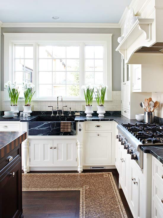 Kitchen With Creamy White Kitchen Cabinets With Soapstone Countertops