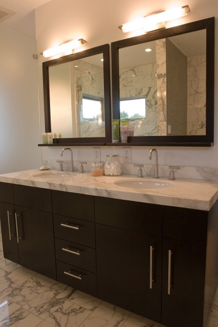with espresso stained double bathroom vanity with marble countertop