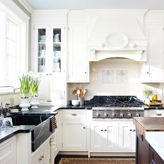 off white kitchen cabinets with soapstone countertops, farmhouse