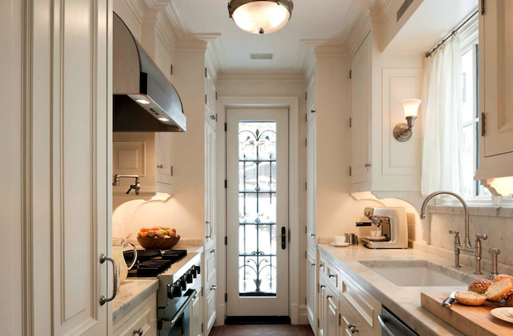 Stunning Traditional Galley Kitchen With White Kitchen Cabinets With Marble  Countertops U0026 Backsplash And Cage Curtains.