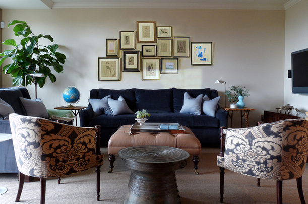 Sophisticated Living Room With Blue Velvet Sofa Loveseat Pale Silk Pillows Clay Beige Tufted Ottoman Caster Legs Navy Tan Fabric