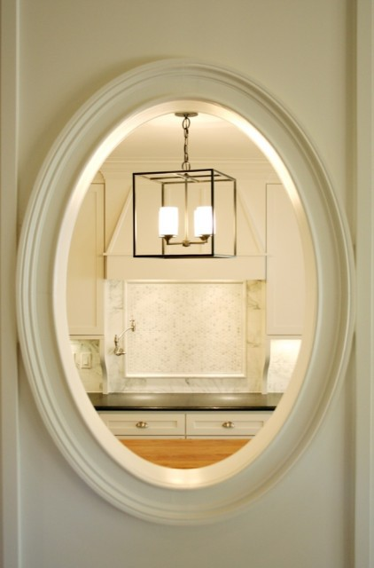 Delicieux Lovely Ivory Swinging Door With Oval Window With View In Kitchen.