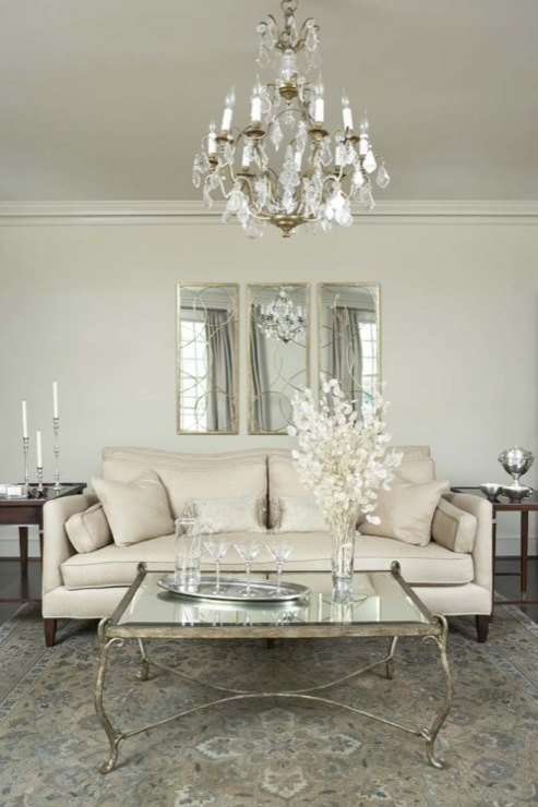 Superb Exquisite Living Room With Arteriors Nikita Mirror In Gold, Brass Crystal  Chandelier, Ivory Linen Sofa, Coffee Stained End Tables An D Antique  Mirrored ... Part 27
