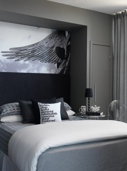 Chic gray bedroom with charcoal gray walls, bed nook, Eileen Gray  Adjustable Table, Kartell Victoria Ghost Chair gray bedding, black pillows  and art.